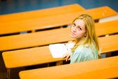 Student girl in auditorium — Stock Photo