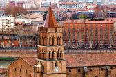 Saint Nicolas church on Toulouse background — Stock Photo