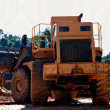 Big tractor working on a site. — Stock Photo