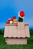 Back view - Santa Claus on roof and gifts — Stock Photo
