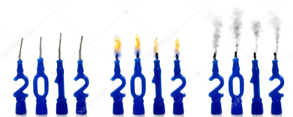 Candle stages of 2012 - New, burning, and extinguished  Stock Photo #12590203