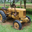Yellow farm tractor — Stock Photo #12604496