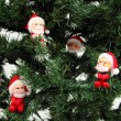 Stock Photo: Santas on pine tree