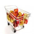 Bunch of gifts in a shopping cart — Stock Photo