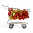 Bunch of gifts in a shopping cart - side view — Stock Photo