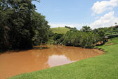 Farm view - river — Stock Photo