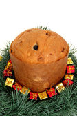 Panettone with gifts around — Stock Photo
