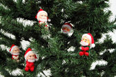 Santas on pine tree — Stock Photo