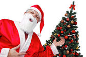 Christmas tree and Santa - Focus on xmastree — Stock Photo