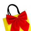 Yellow bag with red bow — Stock Photo