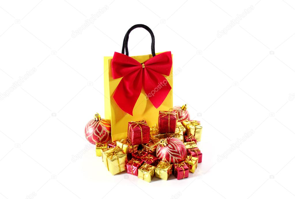 Yellow bag with red bow and ornaments isolated on a white background. — Stock Photo #13362162