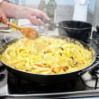 Preparing Paella - Spanish cuisine — Stock Photo #13708813