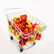 Stock Photo: Bunch of gifts in a shopping cart