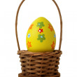 Yellow Easter egg into a basket — Stock Photo #13714676