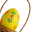 Yellow Easter egg into a basket — Stock Photo #13714727
