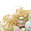 Colored Easter eggs into a nest — Stock Photo