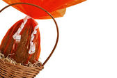 Chocolate Easter Eggs into a basket from corner — Stock Photo