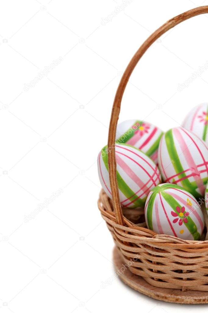 Easter eggs in a basket from corner on white background — Stock Photo #13735761
