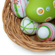 Easter eggs in a basket from corner — Stockfoto
