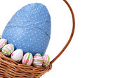 Easter eggs in a basket from corner — Stok fotoğraf