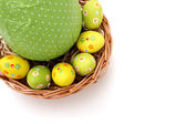 Easter eggs in a basket from corner — Stock fotografie
