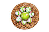 Easter eggs in a basket top view — Stock fotografie