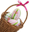 Three Easter eggs in a basket from corner — Stok fotoğraf