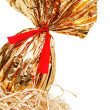 Golden easter egg detail in a nest - Stock Photo