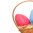 Easter eggs in a basket from corner — Stock Photo #13758212