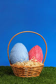 Easter basket on field — Stok fotoğraf