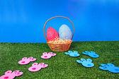 Easter eggs hunt with bunny tracks — Stock Photo