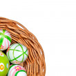 Easter eggs in basket from corner — Stock Photo #13765555