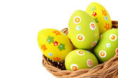 Easter eggs in a basket from bottom corner — Stock Photo
