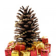 Christmas pine cone and gifts — Stok fotoğraf