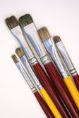 Artist brushes on canvas — Stock Photo