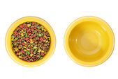 Full and empty dog bowl — Stock Photo