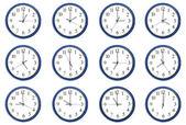 Clocks - Day and night hours — Stock Photo