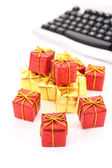 Gifts and keyboard. — Stock Photo