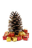 Christmas pine cone and gifts — Stock Photo
