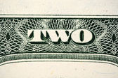 Two dollars bill text — Stock Photo