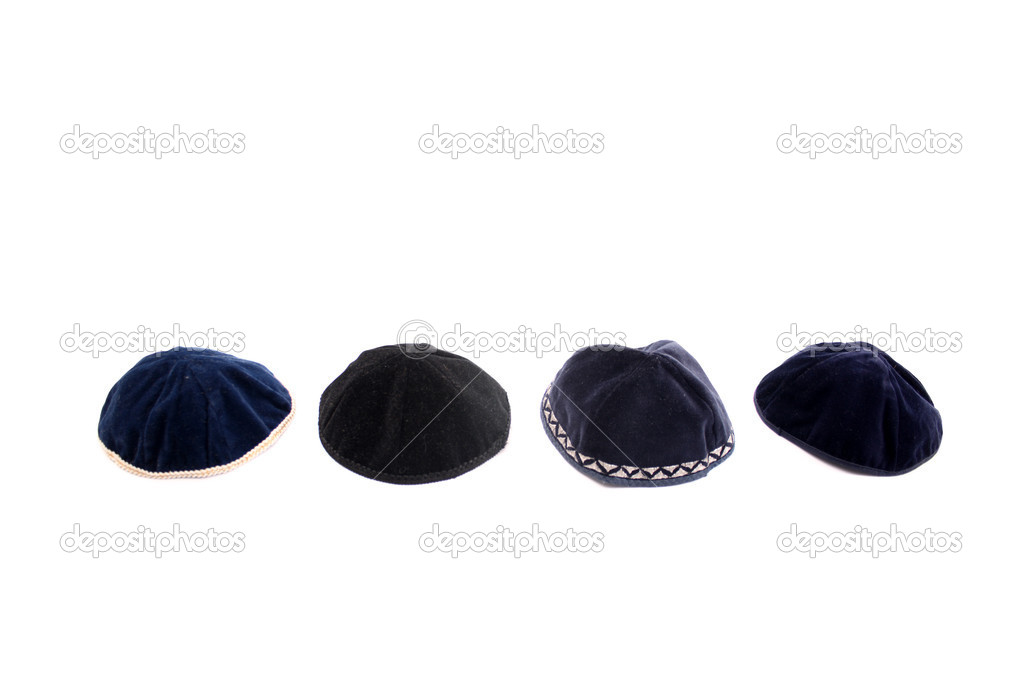 A kippah is a small cap (head covering), is a thin, slightly-rounded skullcap traditionally worn by observant Jewish men. — Stock Photo #19577043