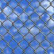 Chainlink fence and sky (Seamless texture) — Stock Photo