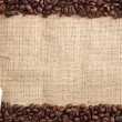 Stock Photo: Coffee beans and sachet