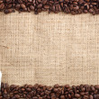 Coffee beans and sachet — Stock Photo