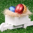 Stock Photo: Colored Easter Eggs and Pushcart