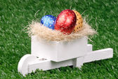 Colored Easter Eggs and Pushcart — Stock Photo