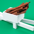 Pushcart with cinnamons — Stock Photo
