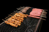 Barbecue skewers on the grill — Stock Photo