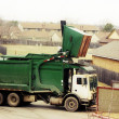 Stock Photo: Big green recycling truck