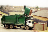 Big green recycling truck — Stok fotoğraf